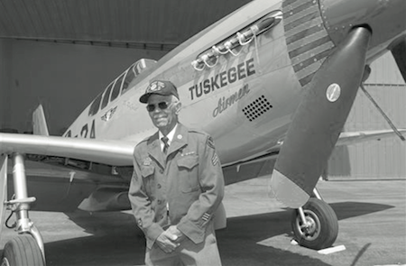 "This April 7, 2011 photo by Bruce Talamon shows Clarence E. ""Buddy"" Huntley Jr., a member of the Tuskegee Airmen, the famed all-black squadron that flew in World War II, posing with a P-51C Mustang fighter plane similar to the one that he was a crew chief on while overseas during the war, at Torrance, Calif., Airport. (AP Photo/Bruce Talamon)"
