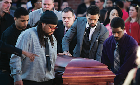 Uncle Turin Carter, centre, and pallbearers wheel the casket of Tony Terrell Robinson, Jr. during his funeral at Madison East High School. (Photo by Reuters)