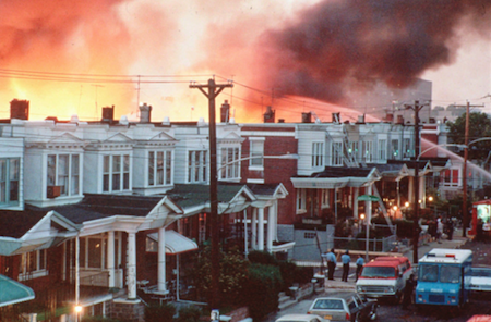 Row houses in Philadelphia burn after officials dropped a bomb on the MOVE house in this May 1985 photo from files. Ramona Africa, the lone adult survivor of the May 13, 1985 fire, and two other MOVE members sued the city of Philadelphia, and the former police and fire commissioners for financial damages in what was the first trial in court to address the MOVE bombing. Photo: AP/Wide World photos