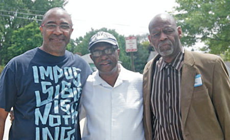 Left: John Milton, Middle: Minister Ronald Smith of New Covenant Church of Christ, Right: Pastor James E. Monroe also of the New Covenant Church of Christ. Photo by Elizabeth Stephens.