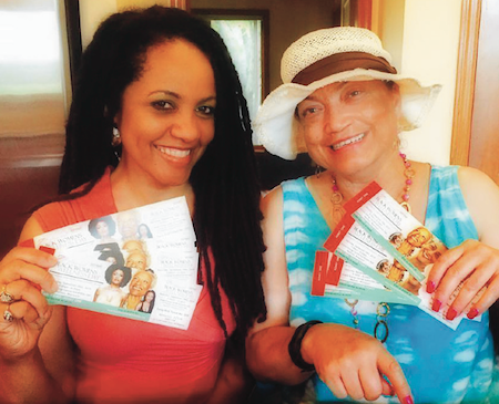 Lisa Peyton-Caire, founder of Black Women's Wellness Foundation, and Brenda Brown holding tickets (available now!) to this year's Black Women's Wellness Day. Photo by Lisa Peyton-Caire